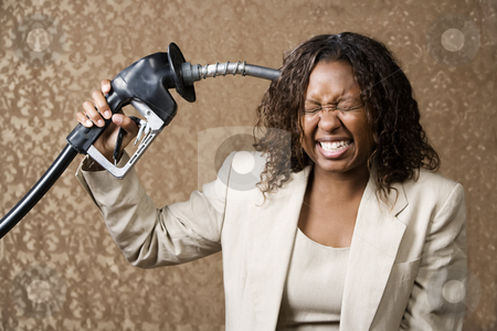 Woman Holding Gas Nozzle to her Head stock photo, Woman holding gas nozzle like a gun to her head by Scott Griessel