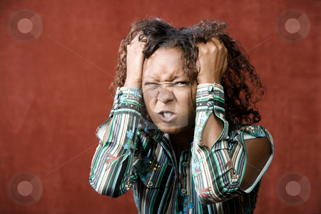Angry Pretty African-American Woman stock photo, Close-Up Portrait of an Angry African-American Woman by Scott Griessel
