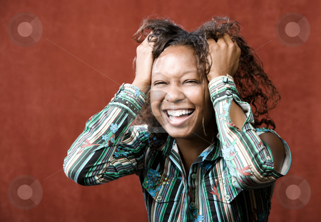 Laughing African-American Woman stock photo, Close-Up Portrait of an Laughing African-American Woman by Scott Griessel
