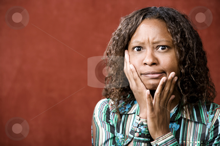 Stressed Pretty African-American Woman stock photo, Close-Up Portrait of a Stressed African-American Woman by Scott Griessel