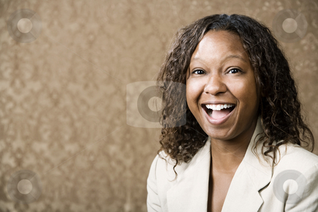 Pretty African-American Woman stock photo, Close-Up Portrait of a Pretty African-American Woman with a Big Smile by Scott Griessel