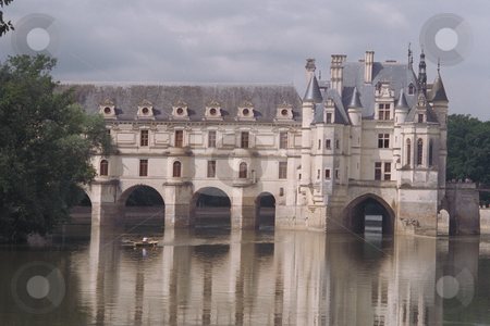 Chenonceau Chateau stock photo, Chenonceau Chateau, Loire Valley, with sculler in foreground on the Cher River  across the Cher River  Home of Diane de Poitiers and Catherine de Medici  Border of Occupied France and Vichy France during World War II by Thomas Marchessault