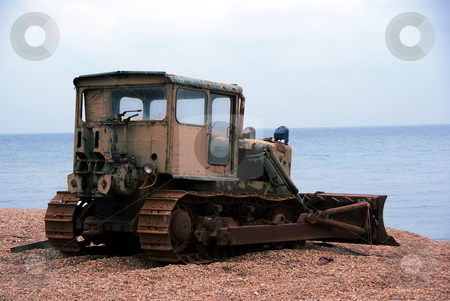 Old worker stock photo, Old and rusty bulldozer on a beach by David Nebesky