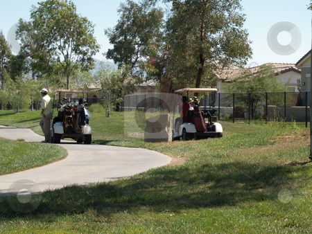 Aproaching the 9th hole stock photo, Golfers approaching the 9th hole in golf carts by Joseph Ligori