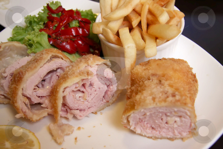 Cordon blue stock photo, Pork cordon blue on plate with fries and salad by Kheng Guan Toh