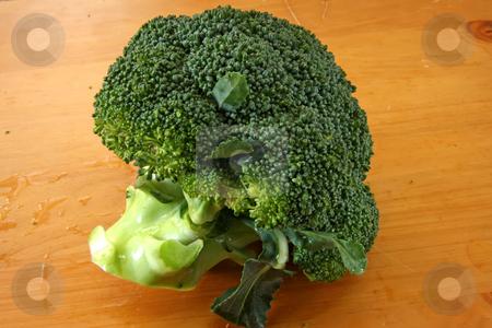 Fresh raw brocolli stock photo, Fresh raw whole brocolli on wooden background by Kheng Guan Toh