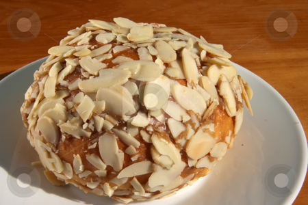 Almond flake bun stock photo, Sweed dessert pastry bun covered with flaked almonds by Kheng Guan Toh