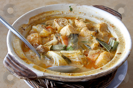 Fish head curry stock photo, Fish head curry in clay pot traditional malaysian cuisine by Kheng Guan Toh