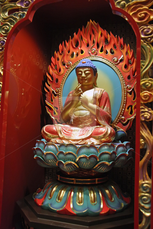 Golden statue of buddha inside a chinese temple stock photo, Golden statue of buddha inside a chinese temple by Kheng Guan Toh