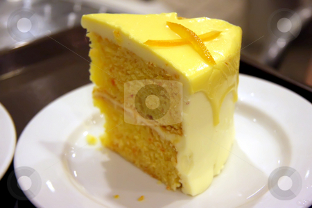Lemon cake stock photo, Yellow lemon cake with icing on white plate by Kheng Guan Toh
