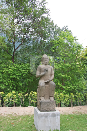 Buddha statue stock photo, Stone buddha statue in meditating position outdoors in nature by Kheng Guan Toh
