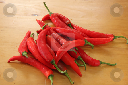 Pile of chillis stock photo, Pile of red raw chillis typical ingredient for asian cooking by Kheng Guan Toh