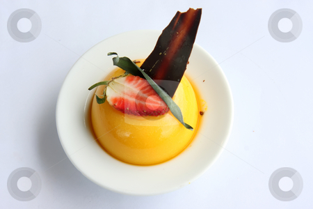 Fancy pudding stock photo, Yellow pudding fancy decorated with strawberry garnish by Kheng Guan Toh