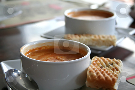 Lobster bisque stock photo, Bowl of lobster bisque in white bowl casual restaurant setting by Kheng Guan Toh