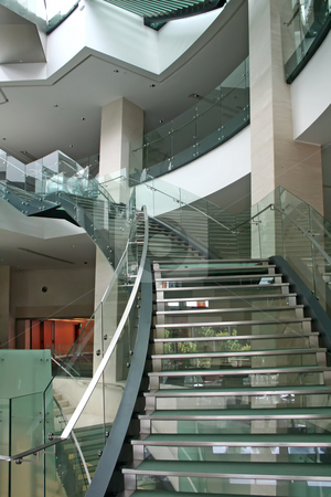 Modern staircase stock photo, Modern glass and steel piral staircase with skylight by Kheng Guan Toh