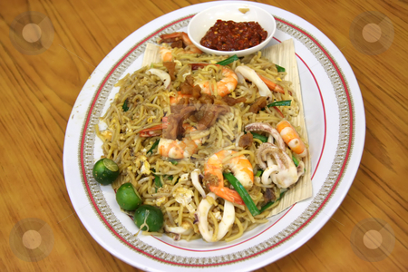 Chinese noodles stock photo, Chinese fried seafood noodles with prawns and squid by Kheng Guan Toh