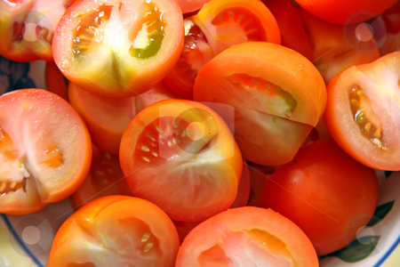 Sliced tomatoes stock photo, Fresh cut sliced raw red tomatoes arranged in bowl by Kheng Guan Toh