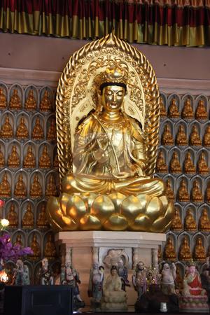 Gold statue stock photo, Golden statue of Kuan Yin godess of mercy by Kheng Guan Toh