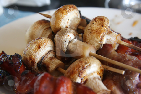 Grilled meat and mushrooms stock photo, Grilled meat and mushrooms skewered on wooden sticks by Kheng Guan Toh