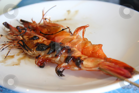 Grilled prawns stock photo, Grilled prawns in shell skewered on sticks by Kheng Guan Toh