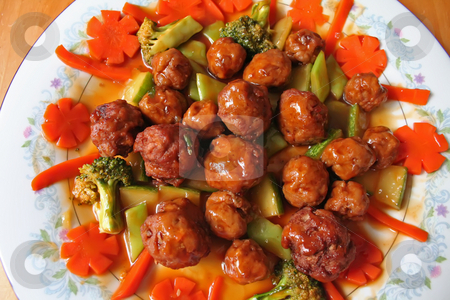 Meatballs and vegetables stock photo, Meatballs with vegetables and sauce on a plate by Kheng Guan Toh