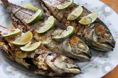Grilled fish stock photo, Grilled whole fish with lemons on plate by Kheng Guan Toh