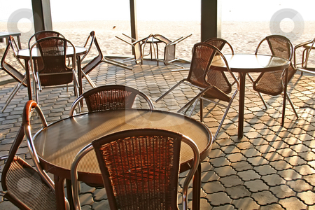 Beachside cafe stock photo, Tropical style open-air cafe seaside next to beach early dawn light streaming in by Kheng Guan Toh