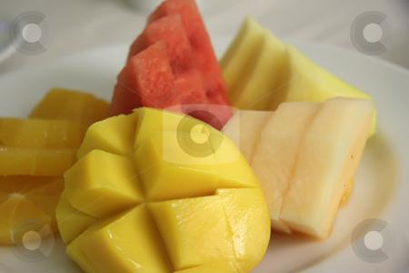 Cut fruits stock photo, Assorted cut tropical fruit presentation on plate by Kheng Guan Toh