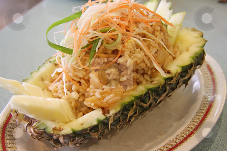 Pineapple rice stock photo, Pineapple fried rice traditional thai cuisine fancy presentation by Kheng Guan Toh