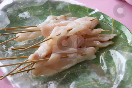 Raw fish skewers stock photo, Raw fish on wooden skeweres prepared for grilling by Kheng Guan Toh