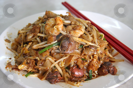 Spicy fried noodles stock photo, Spicy fried chinese flat rice noodles with seafood by Kheng Guan Toh