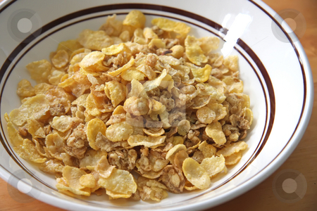 Breakfast cereal stock photo, Closeup of breakfast cereal corn flakes with almonds by Kheng Guan Toh