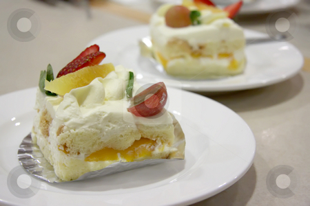 Cream chiffon cake  stock photo, Cream chiffon cake with fruits and icing by Kheng Guan Toh