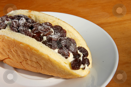 Cake with raisins stock photo, Sweet cream filled cake dessert with raisins by Kheng Guan Toh