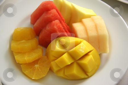 Cut fruits stock photo, Assorted cut tropical fruit presentation on plate by Kheng Guan Toh