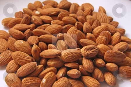 Pile of almonds stock photo, Pile of almond nuts closeup on white background by Kheng Guan Toh