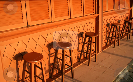 Bar stools stock photo, Bar stools of a closed poolside bar in the daytime by Kheng Guan Toh
