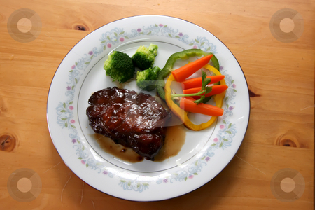 Porkchop with vegetables stock photo, Porkchops with gravy and vegetables on plate by Kheng Guan Toh