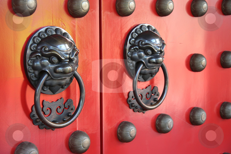 Chinese temple doorway stock photo, Ornate doorways to traditional chinese temple with guardian door knockers by Kheng Guan Toh