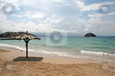 Beach seaside stock photo, Seaside beach with shade umbrella on an island in Venezuela by Kheng Guan Toh