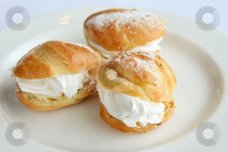 Cream puffs stock photo, Cream puffs fancy choux pastry with powdered sugar by Kheng Guan Toh