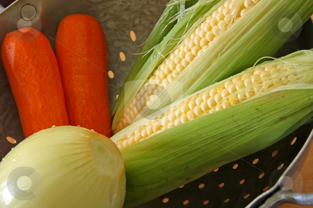 Mixed vegetables stock photo, Corn on the cob with carrots and onion mixed vegetables by Kheng Guan Toh