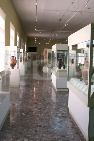 Museum exhibit stock photo, Museum exhibits of ancient relics in glass cases by Kheng Guan Toh