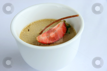 Fancy pudding stock photo, Fancy brown pudding decorated with strawberry garnish by Kheng Guan Toh