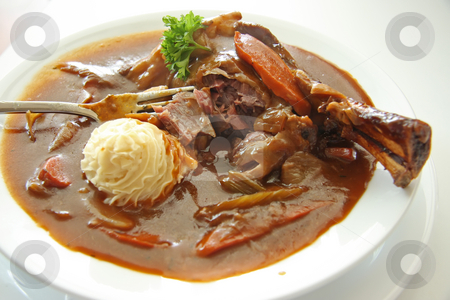 Leg of lamb stock photo, Leg of lamb stew with gravy and vegetables by Kheng Guan Toh