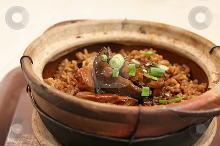 Claypot rice stock photo, Plate of asian squid and rice in claypot by Kheng Guan Toh