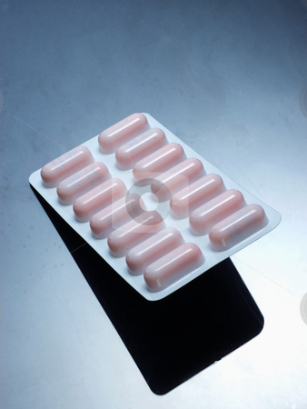 Pills stock photo, Drugs on grey background by Simon Jeacle