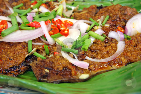 Spicy grilled fish stock photo, Spicy grilled rayfish traditional asian cuisine on banana leaf by Kheng Guan Toh