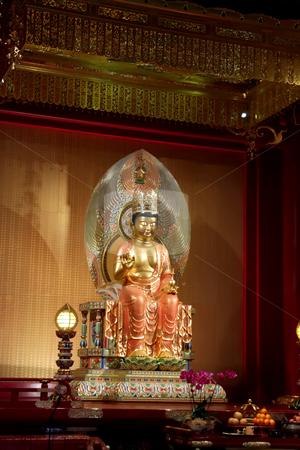 Golden buddha statue stock photo, Golden statue of buddha inside a chinese temple by Kheng Guan Toh