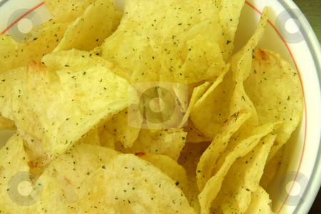 Potato chips stock photo, Seasoned fried potato chips in white bowl by Kheng Guan Toh